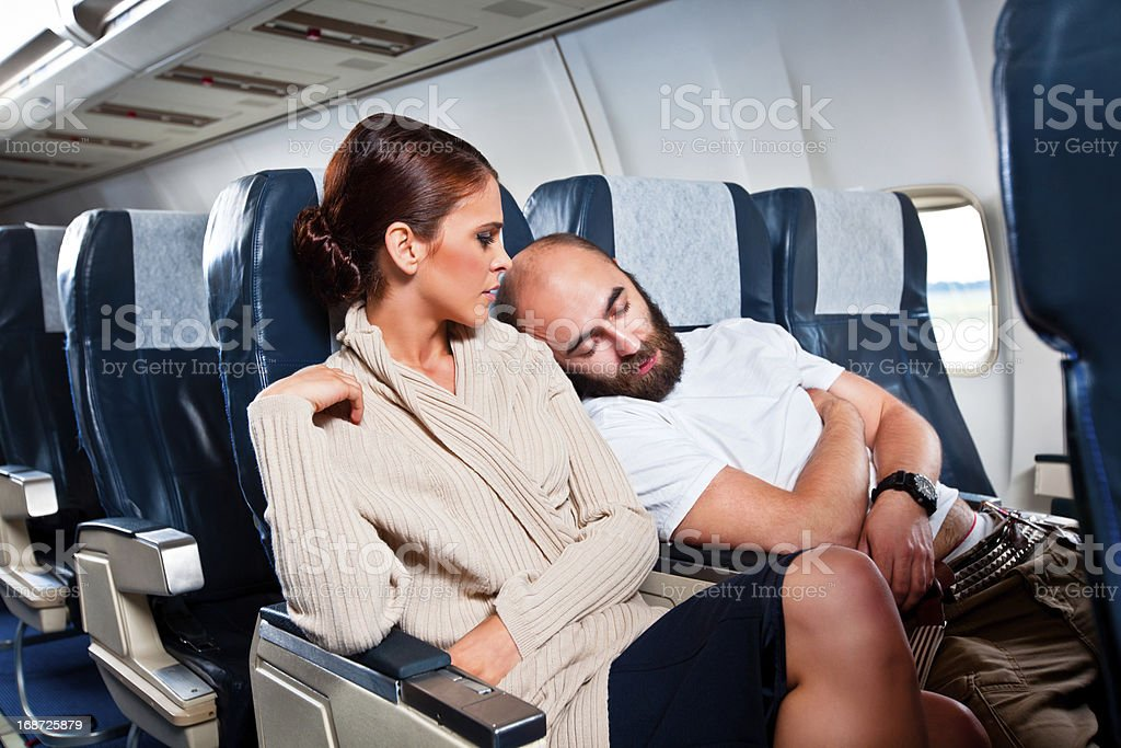 Rude Passenger On The Airplane Stock Photo & More Pictures