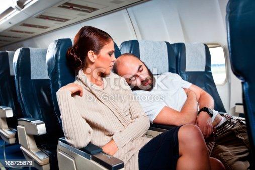 istock Rude passenger on the airplane 168725879
