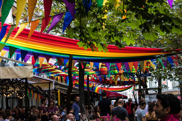 Rue des Archives, heart of Le Marais neighborhood in Paris decorated with LGBT flags stock photo