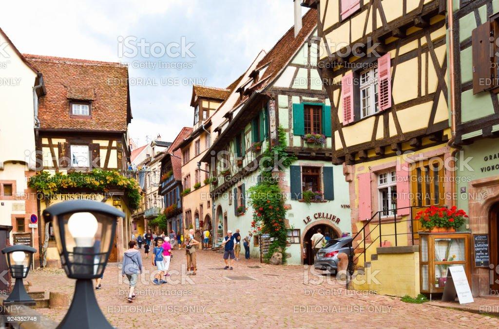 Rue du General de Gaulle in Riquewihr village, France stock photo
