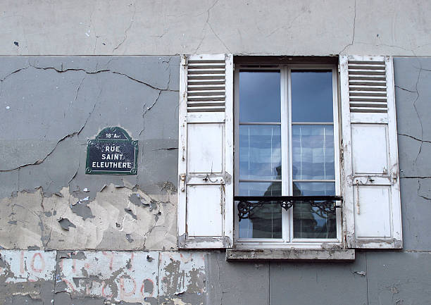 rue saint eleuthere street sign with old window stock photo