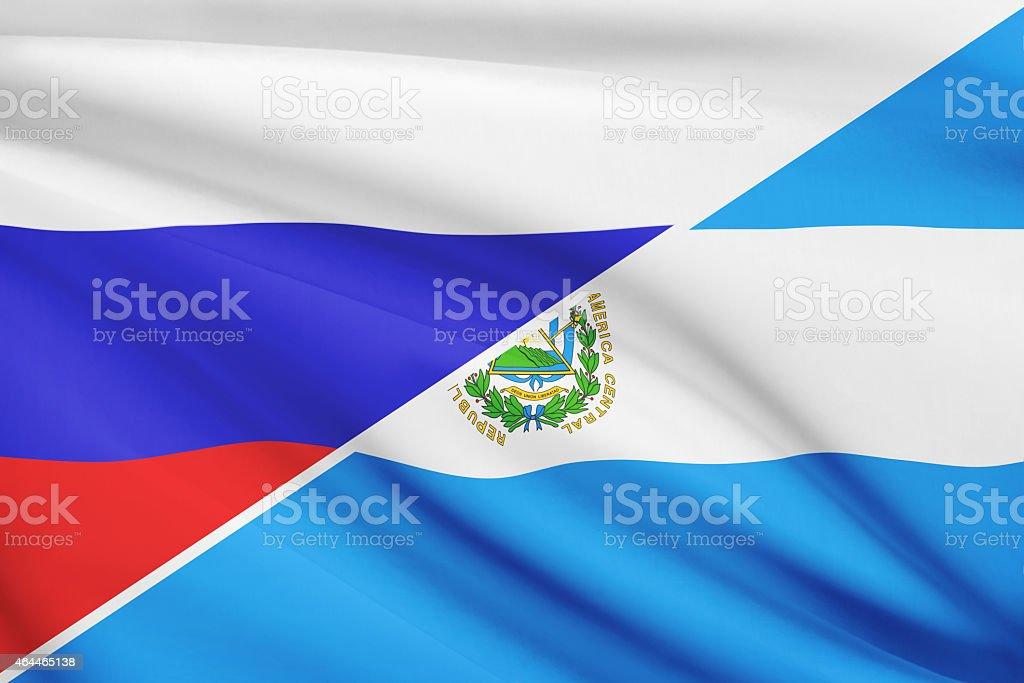 Ruffled flags. Russia and Republic of El Salvador. stock photo