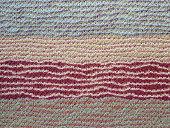 Closeup of abstract floor rug.