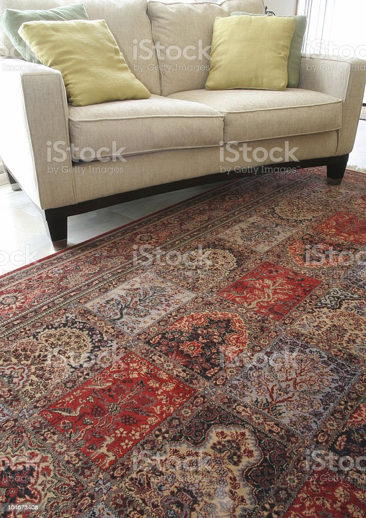 Rug and sofa stock photo