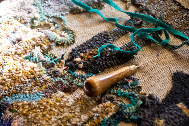 Rug hooking project with turquoise fabric stock photo