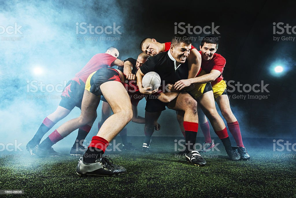 Rugby action at night. stock photo