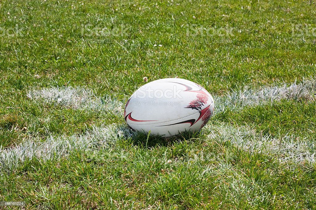Rugby ball lying on line stock photo