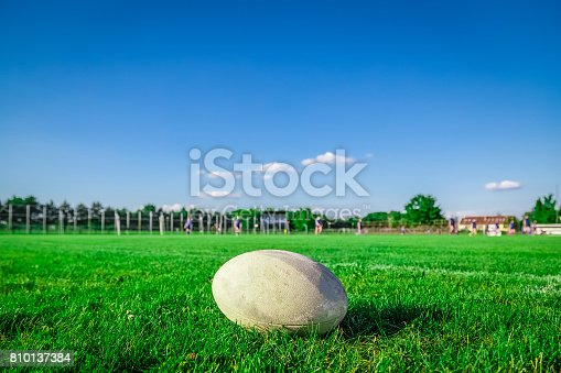 istock Rugby ball on field and players in the background 810137384