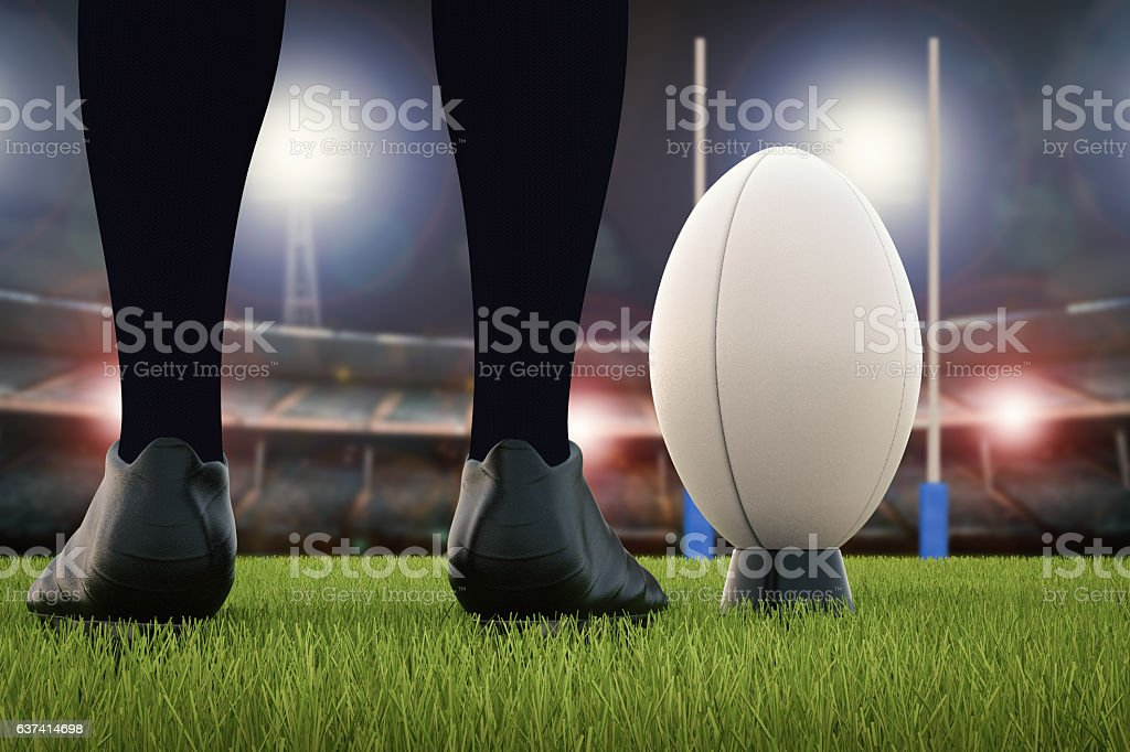 rugby ball with rugby posts on field stock photo