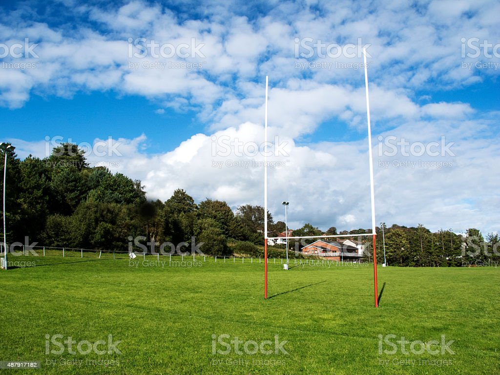 Rugby field with goalposts and summer sky stock photo