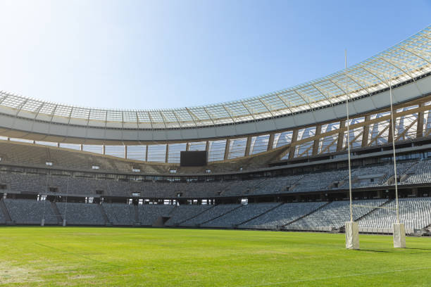 Rugby goal post on a sunny day in the stadium stock photo