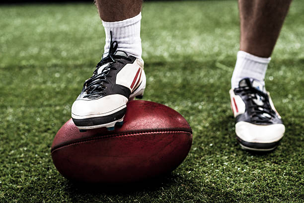 Rugby Foot of rugby player on the ball studded stock pictures, royalty-free photos & images