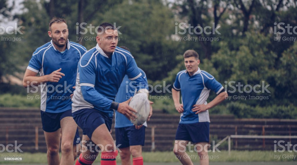 Rugby Rugby players doing warm up exercises before game. Adult Stock Photo
