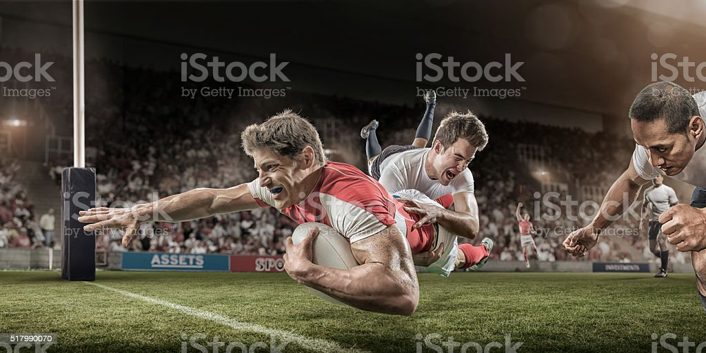 Rugby Player Dives to Score Whilst Being Tackled stock photo