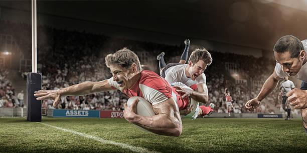 jugador de rugby dives para puntaje mientras que s'aborde - rugby fotografías e imágenes de stock