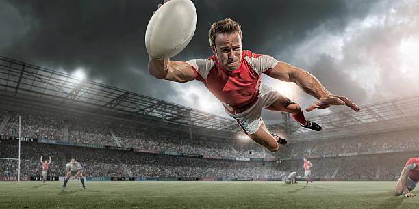 jugador de rugby buceo en mid aire por puntaje - rugby fotografías e imágenes de stock