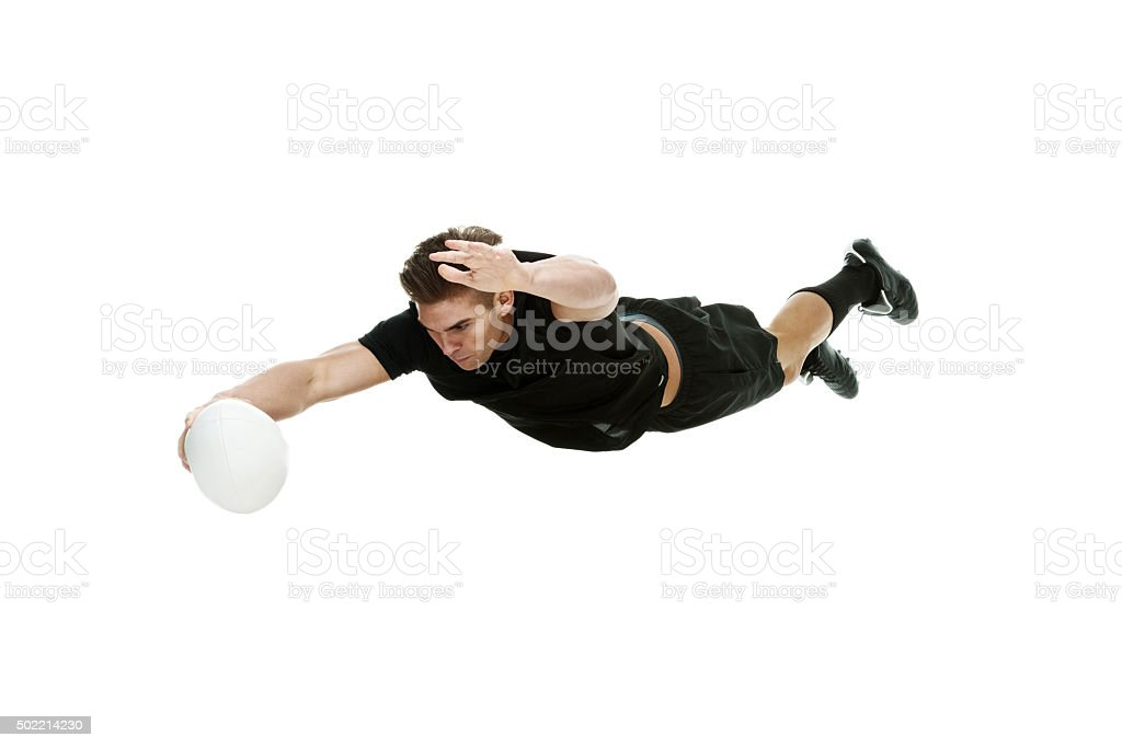 Rugby player diving into ball stock photo