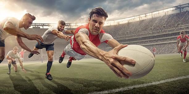 Joueur de Le rugby, plongée dans l'Air prêt à marquer - Photo