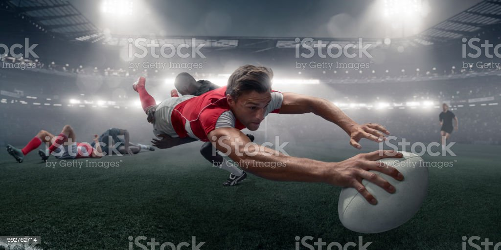 Rugby Player In Mid Air Dive With Ball To Score stock photo