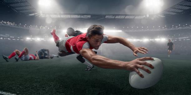 rugby-spieler in mitte luft tauchgang mit ball, partitur - rugby stock-fotos und bilder