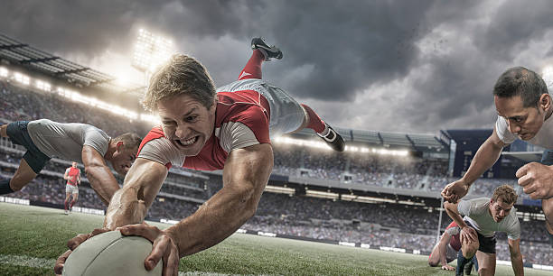 rugby player in mid air scores with heroic dive - rugby stock photos and pictures