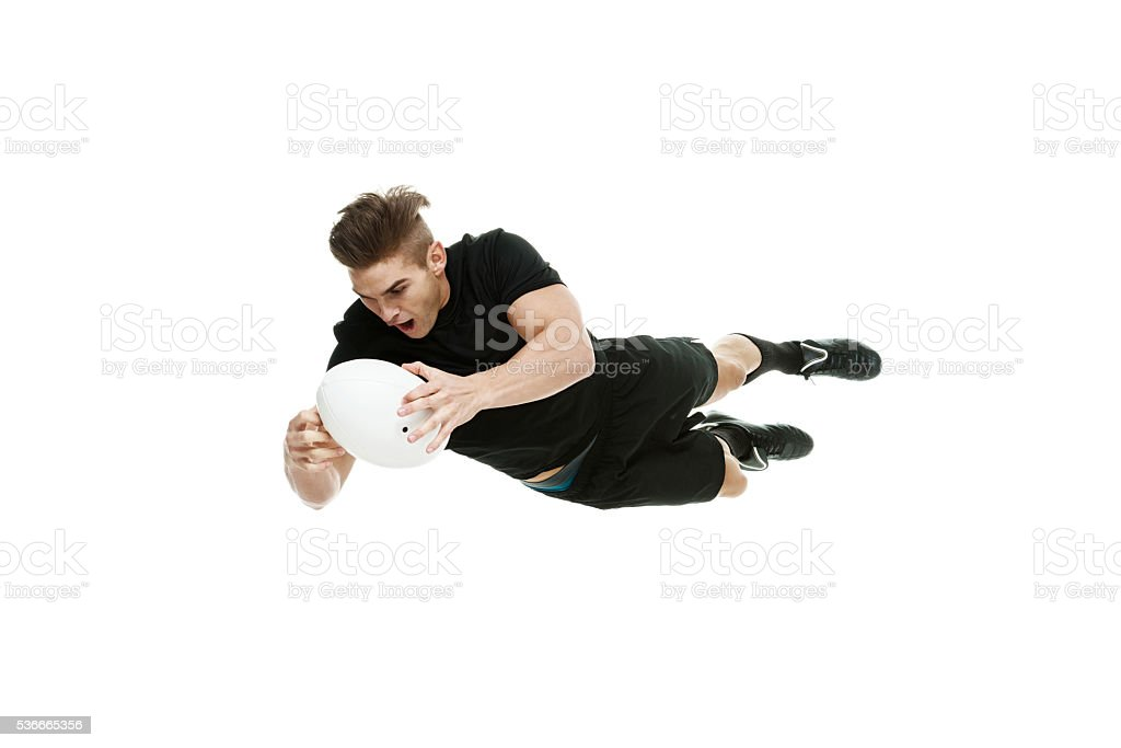 Rugby player jumping with ball stock photo