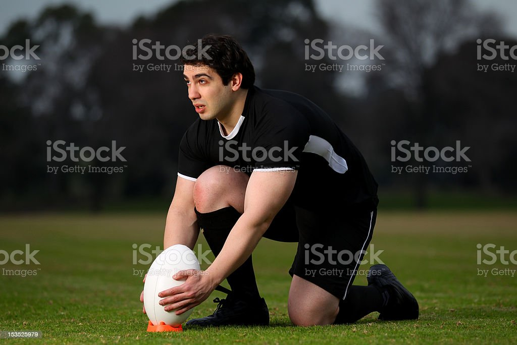 Rugby Player lines up a kick stock photo