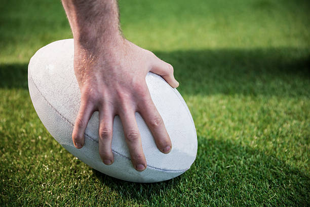 rugby player posing a rugby ball - rugby ball stock photos and pictures