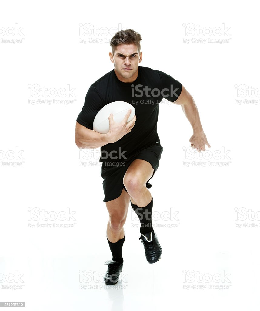 Rugby player running stock photo