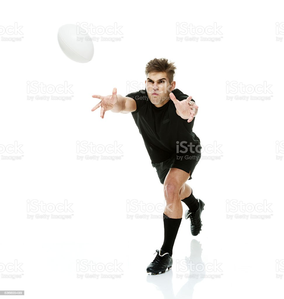 Rugby player throwing a ball stock photo