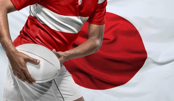 Rugby-Spieler mit Ball und japanischer Flagge – Foto