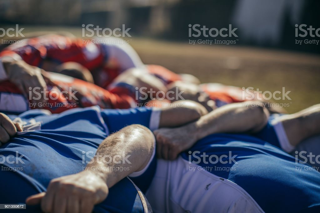 Rugby players embracing stock photo