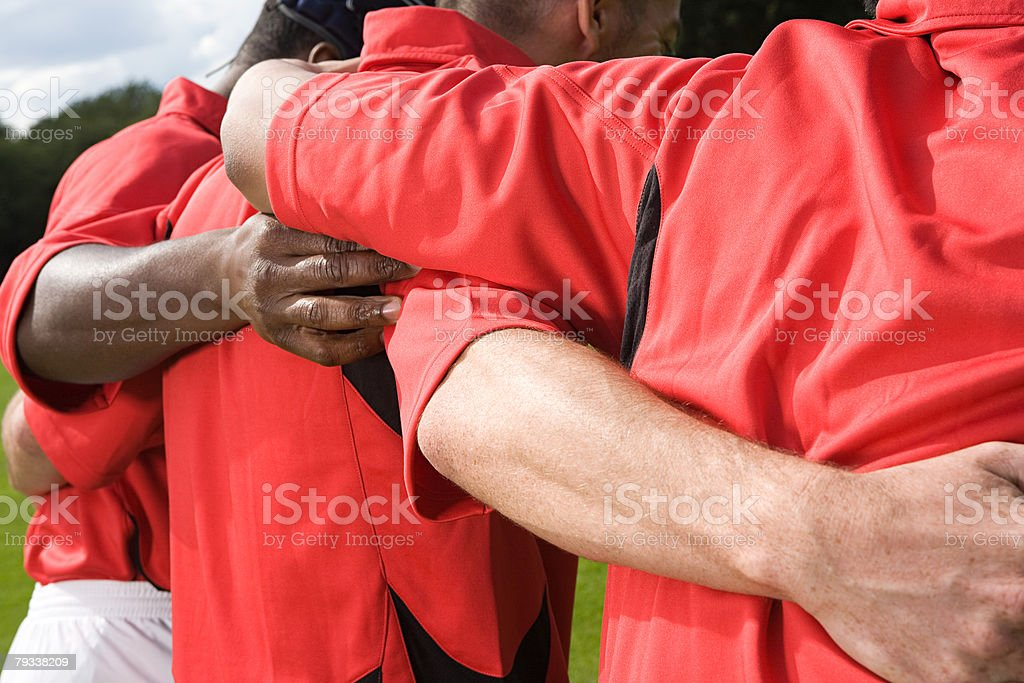 Rugby players in a scrum stock photo