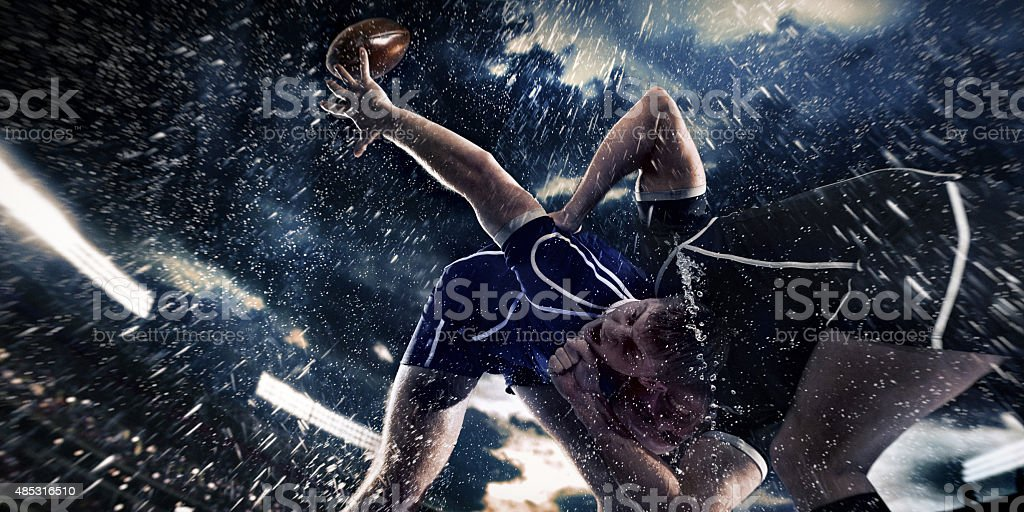 Rugby players on a stadium stock photo