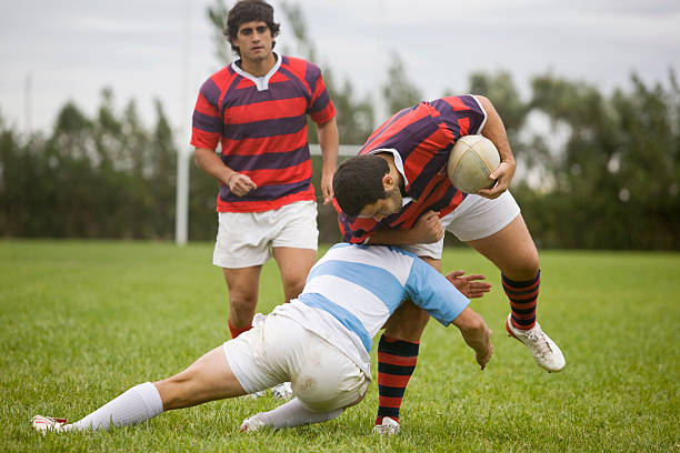 Rugby Players tackling stock photo