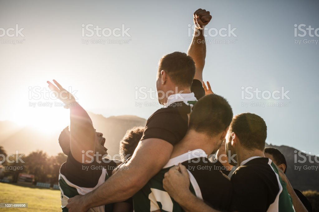 Rugby team celebrating the victory stock photo