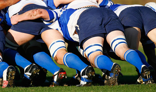 Rugby Union Scrum Rugby Union players push in a scrum studded stock pictures, royalty-free photos & images