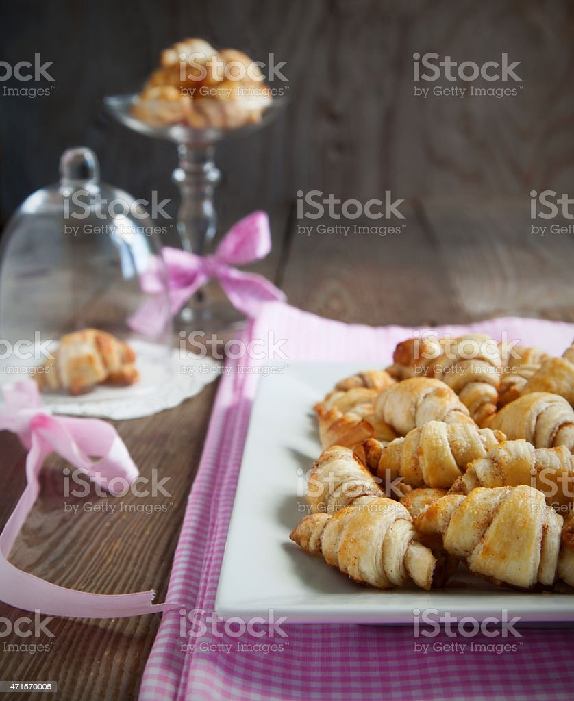 Rugelach with cinnamon and sugar filling on the wooden table. royalty-free stock photo