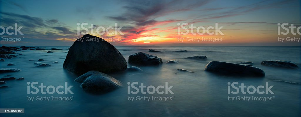 Rugen Island Seascape with Boulders against Cape Arkona at Sunset royalty-free stock photo