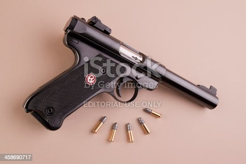 Kirksville, Missouri, United States - November 21, 2012: Ruger Mark III target pistol. Image shows the .22 caliber pistol at an angle with target ammo.