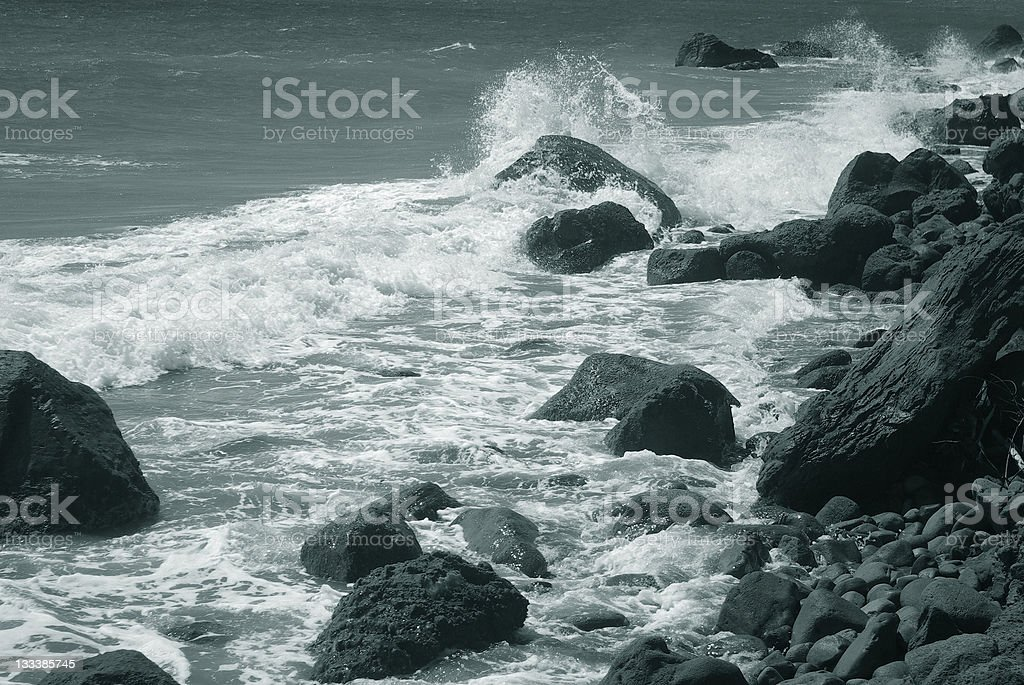 rugged and rocky coastal scenic with rough surf royalty-free stock photo