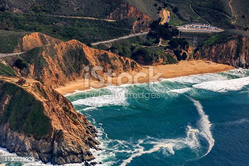 Rugged coastal cliffs by the Devil's Slide bunker and Gray Whale Beach in San Mateo County, Northern California, flying from San Francisco, USA