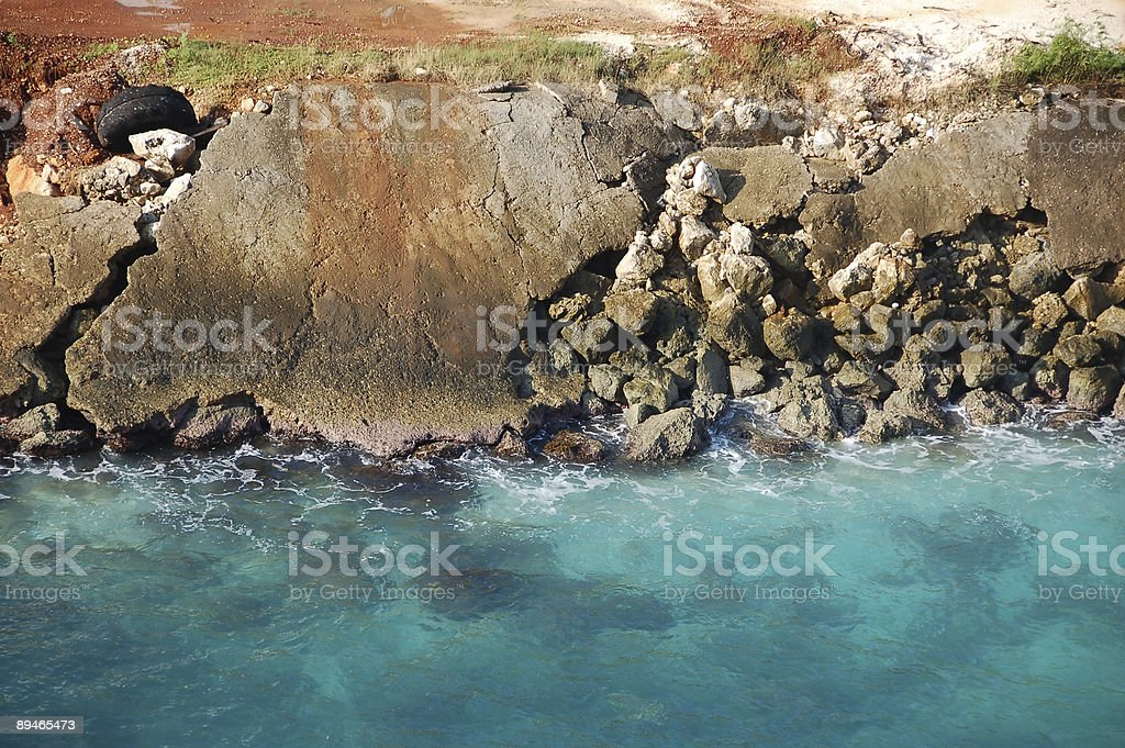 Rugged coastline under bright sun royalty-free stock photo