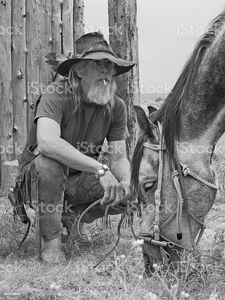 Rugged cowboy with his horse royalty-free stock photo