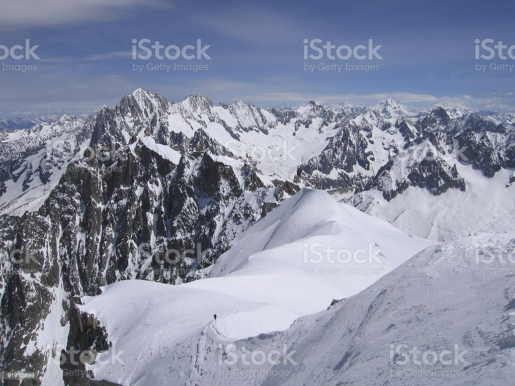 Rugged French alps and mountaineers on a ski slope royalty-free stock photo