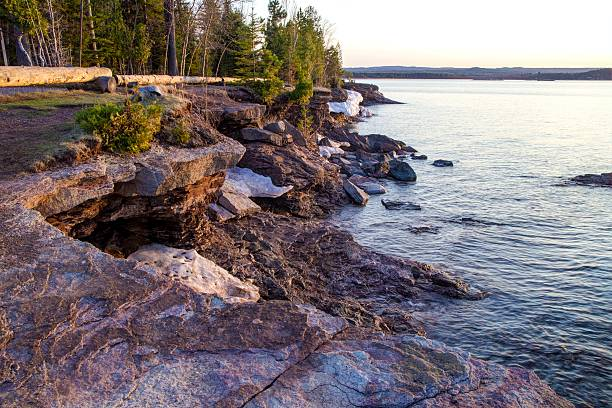 Rugged Lake Superior Shore Of Presque Isle Park Marquette Michigan. Rugged lakeshore of Presque Isle Park.This beautiful park is located in the heart of Marquette along the shores of Lake Superior. The Upper Peninsula's largest city is renowned for its beautiful parks and activities for outdoor enthusiasts. rocky coastline stock pictures, royalty-free photos & images