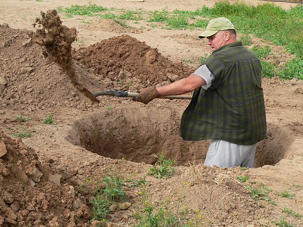 royalty free digging hole pictures images and stock photos istock
