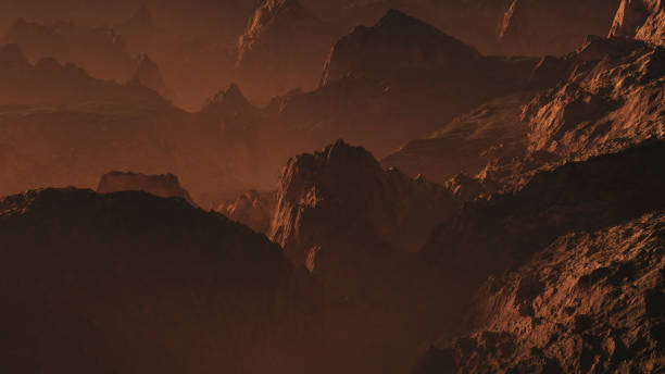 Rugged mountains at hazy sunset. stock photo