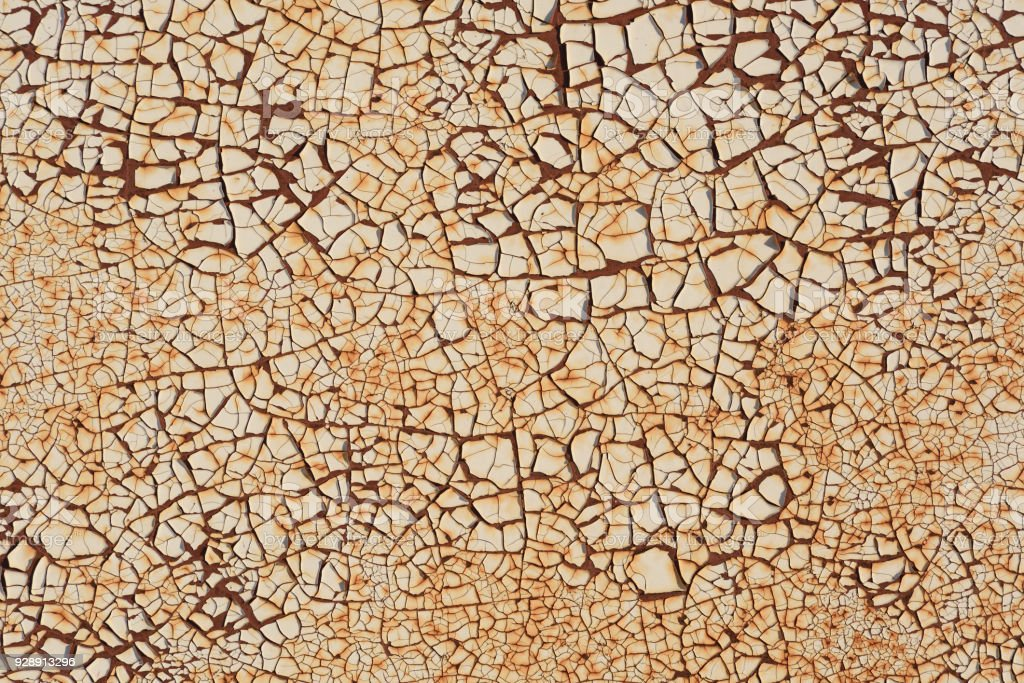 Rugged texture of finely cracked paint on rusty surface background stock photo