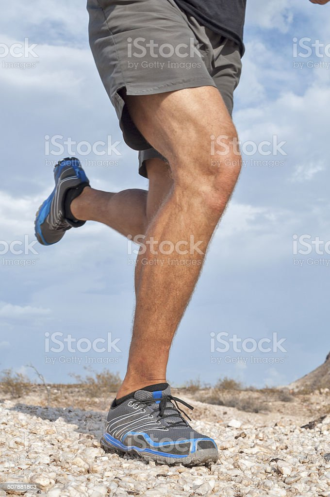 Rugged trail running stock photo